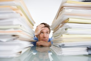 Man surrounded by paperwork